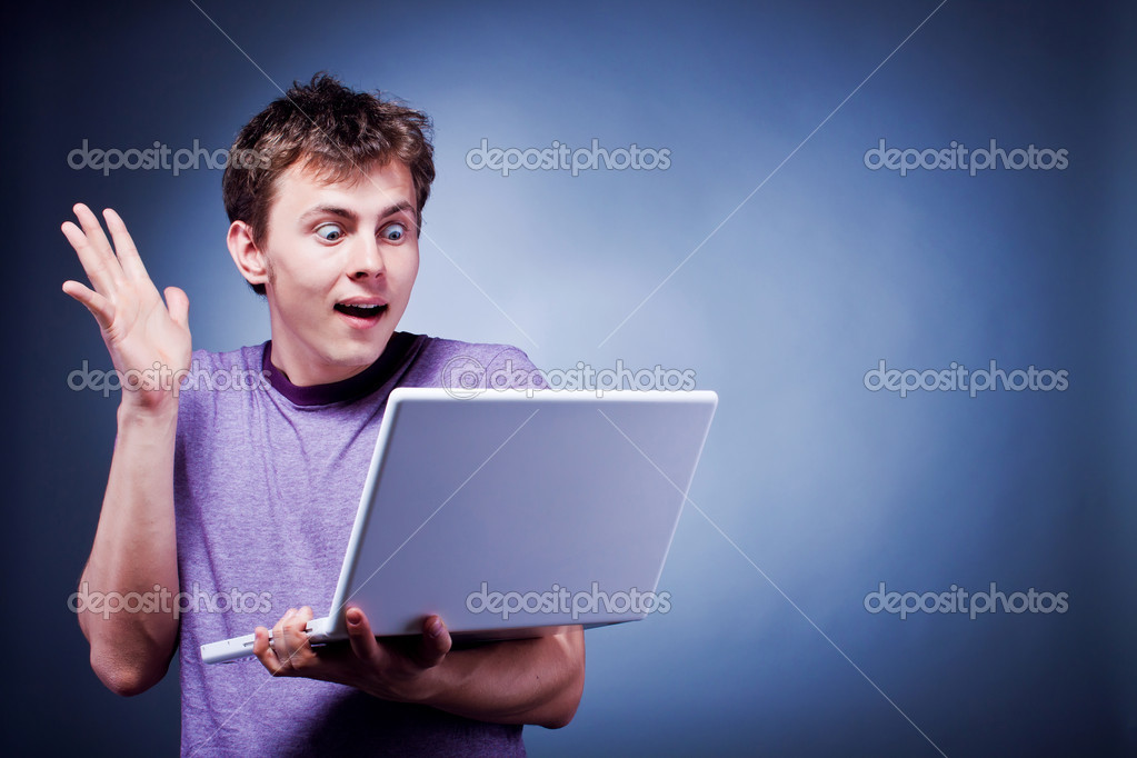 Surprised happy man with laptop — Stock Photo #5816493