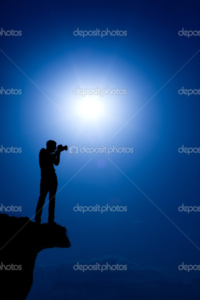 Photographer make a shot on the top of hill  Stock Photo #5912643