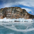 Stockfoto: Isolated rock and frozen sea.