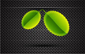 Leaves on carbon background — Stock Vector