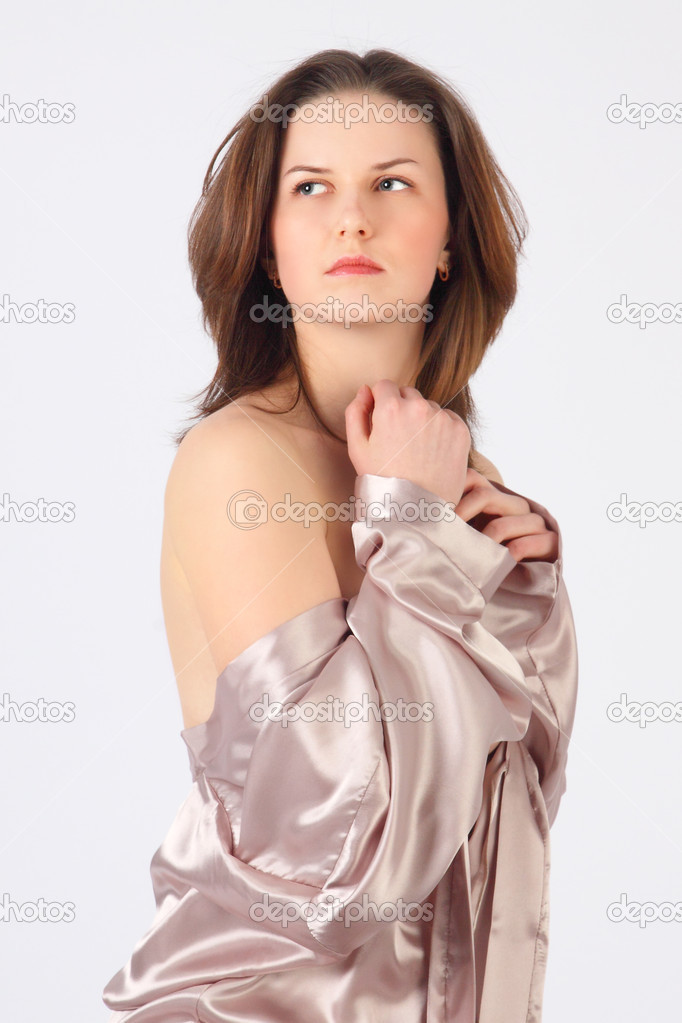 The thoughtful girl in a silvery dressing gown looks in a distance — Stock Photo #5644724