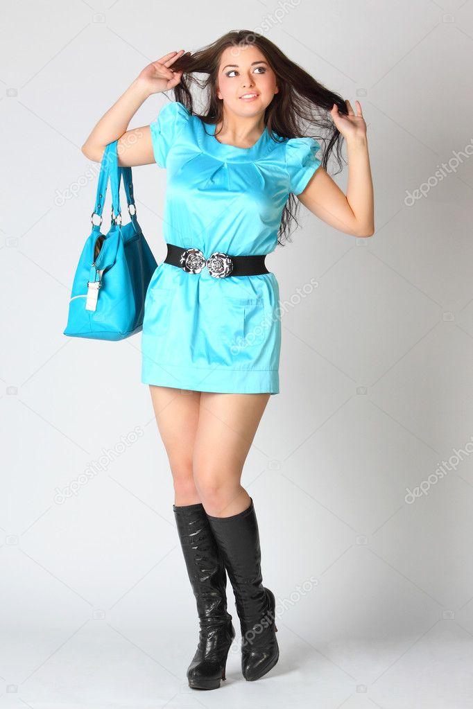 das m dchen in einem blauen kleid und schwarzen stiefeln stockfoto korvin79 5668833. Black Bedroom Furniture Sets. Home Design Ideas