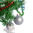 Fir tree branch with silver ball on a white background. — Стоковая фотография
