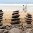 Balance volcanic pebbles in the beach — Stock Photo