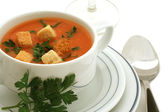 Tomato soup with croutons in ceramic bowl on white — Stock Photo