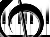Treble clef and keys of the piano — Stock Photo