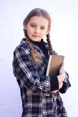 Young girl holding a book — Stock Photo