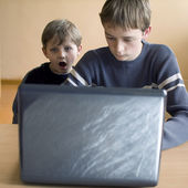 Two boys sitting at the computer — Stock Photo