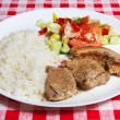 Meats, rice and vegetables on white plate. — Stock Photo