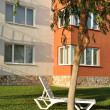 Stock Photo: Sunlounger in courtyard.