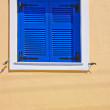 Stock Photo: Blue shuttered window in town of Firon Greek island of Santorini
