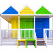 Stock Photo: Colorful, wooden beach huts isolated on white