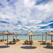 Stock Photo: Empty beach with sunshades