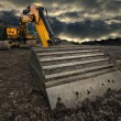 Threatening excavator - Stock Photo
