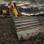 Threatening excavator — Stock Photo