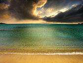 Dramatic, stormy sky approaching the beach — Stock Photo