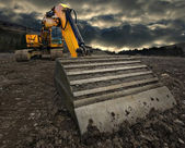 Threatening excavator — Stock Photo