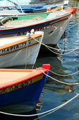Traditional greek fishing boats in harbour — Stok fotoğraf