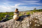 Stones on the beach on blue sky background — Stock Photo