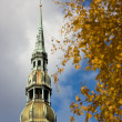 Stock fotografie: Peter's Cathedral in autumn in Riga
