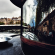 Reflection in the windows of Paris on a barge - Stock Photo