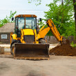 Tractor is digging — Stock Photo #5872148