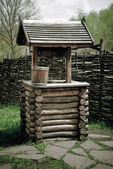 Old wooden well water — Stock Photo