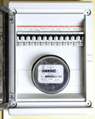 Toggle and electric meter — Stock Photo