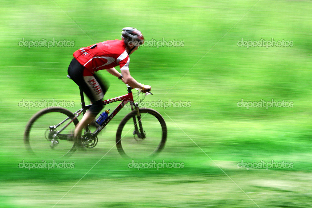 Mountain bike race in a forest in denmark,  Shot with low shutter speed to achieve motion blur  — Stock Photo #5463814