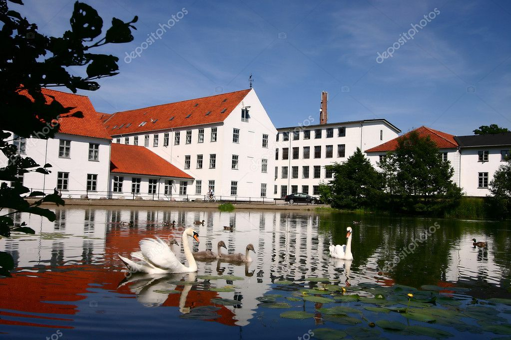 Reflexion of a traditional building built in front of a lake in denmark — Stock Photo #5564228