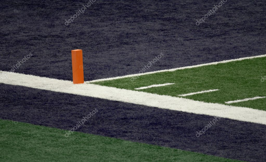 Corner of a football field blue end zone with orange pylon  Stock Photo #6114248