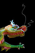 Black background of the Chinese dragon — Stock Photo