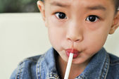 The boy with the straw — Stock Photo