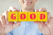 Salesman took the building blocks to express the meaning of good — Stock Photo