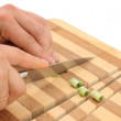Knife cuts wood cutting board — Stock Photo
