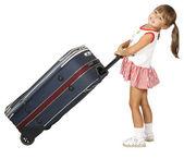 Child pulls luggage — Stock Photo