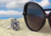 Jewelry on beach — Stock Photo
