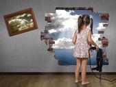 Child girl break the wall — Stock Photo