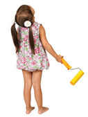 Little girl with roller for paint — Stock Photo