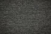 Dunklen grau stoff hintergrund — Stockfoto
