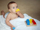 Baby with brick — Foto Stock