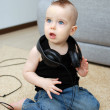 Baby in earphones — Stock Photo #5492402