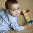 Little boy with intellectual toy — Stock Photo