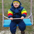 Royalty-Free Stock Photo: Happy boy on swing