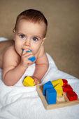 Baby with brick — Stock Photo