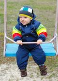 Happy boy on swing — Stock Photo
