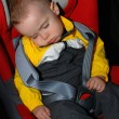 Little boy sleeping in car seat — Stock Photo