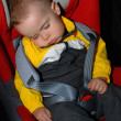 Stock Photo: Little boy sleeping in car seat
