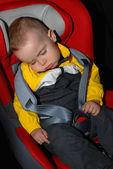 Little boy sleeping in car seat — Stock Photo