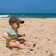 Foto Stock: Little boy on sand